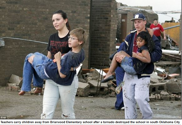 teachers carrying children