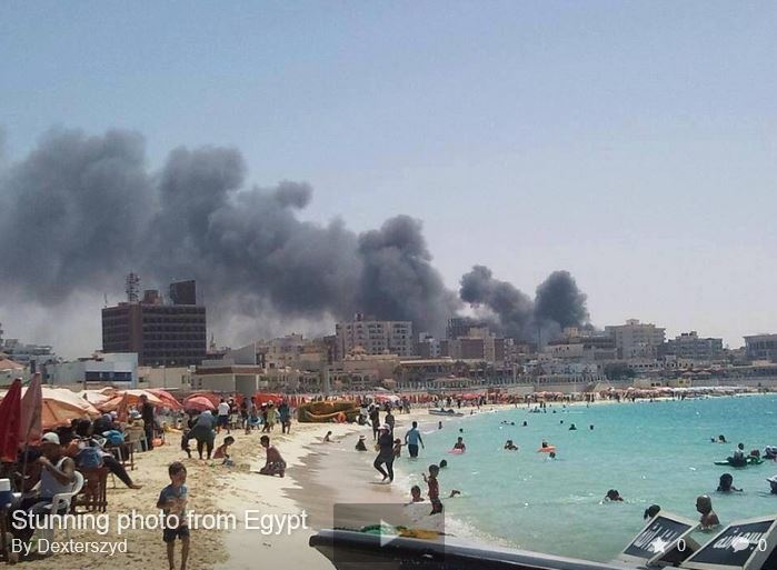 Egyptians at beach while Cairo burns