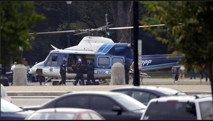DC police remove a victim of the shooting