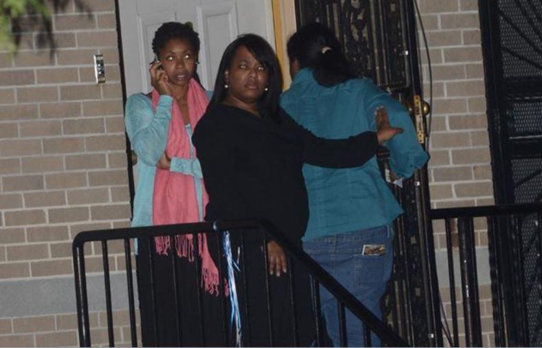 sisters in doorway