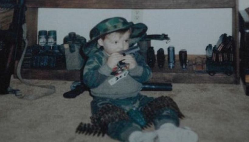 baby adam with gun