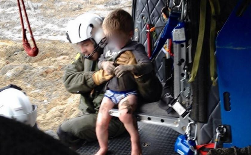 boy rescued from mudslide 2