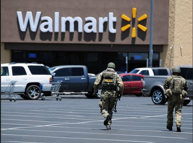 cops in fatigues running toward walmart