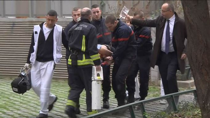 victim with french interior minster carrying bag