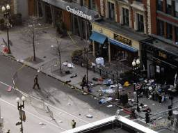 Debris is seen along Boylston Street after explosions went off at the 117th Boston Marathon in Boston